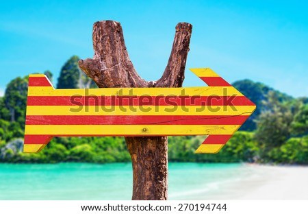 Catalonia Flag wooden sign with beach background - stock photo