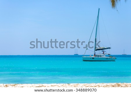 Catamaran at the tropical beach of Cuba - stock photo