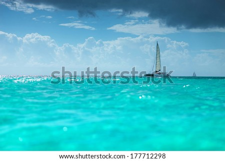 catamaran boat in the turquoise waters of the caribbean sea - stock photo