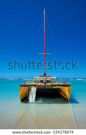Catamaran on Waikiki beach, Hawaii - stock photo