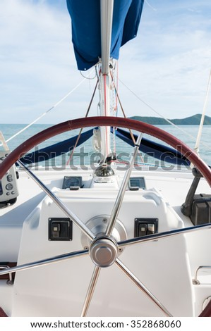 Catamaran Yacht steering wheel and controllers, traveling in a luxury lifestyle in Phuket, Thailand