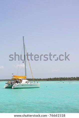 catamarana and people swiming in caribbean sea - stock photo