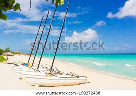 Catamarans at the beautiful beach of Varadero in Cuba - stock photo