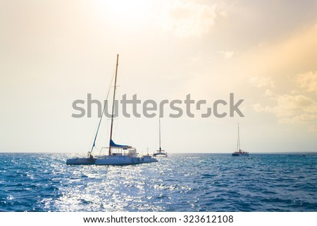 Catamarans cruising the sea in the tropical paradise, Dominican Republic - stock photo