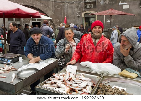 CATANIA - APRIL 5: sellers and byers on the famous fish market in Catania. This market is also tourist attraction in Catania, Sicily, Italy on April 05, 2014. - stock photo