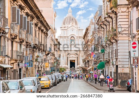 CATANIA, ITALY - SEP 17, 2014: Unidentified people on the street of Catania, Italy. With 300.000 citizens, Catania is the second-largest city in Sicily and the tenth in Italy. - stock photo