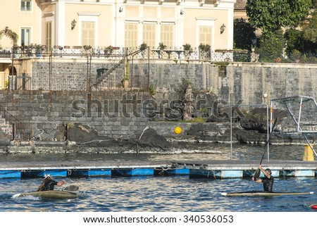 Catania,  Sicily, Italia - January 15, 2015: People kayaking and playing Canoe Polo in the Mediterranean sea at the coast of Catania.