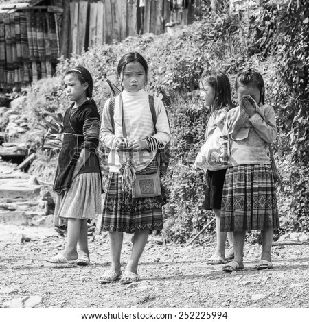 CATCAT, VIETMAN - SEP 20, 2014: Unidentified Hmong children in traditional clothes in Catcat village, Vietnam. Hmong is a minority ethnic group of Vietnam