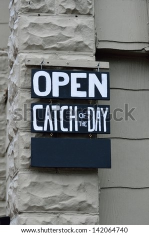 Catch of the day sign at local seafood restaurant - stock photo