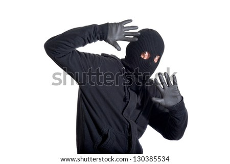 Catch the burglar concept, thief with balaclava caught, isolated on white background - stock photo