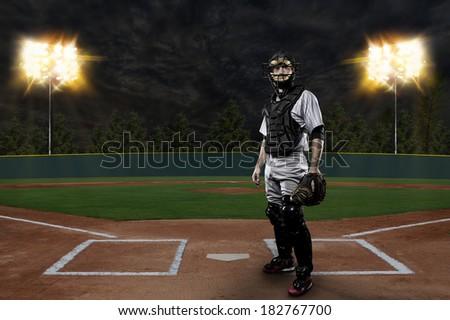 Catcher Baseball Player on a baseball Stadium. - stock photo