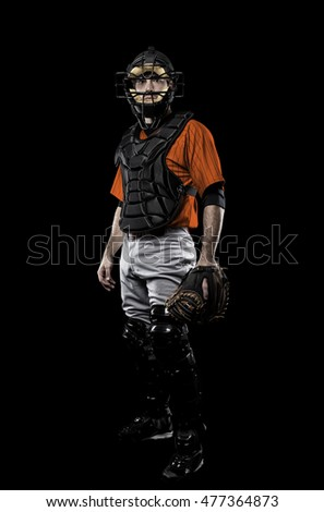 Catcher Baseball Player with a orange uniform on a black background.