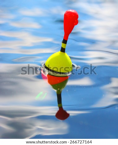 Catching of fish. Fishing bobber on the water. - stock photo