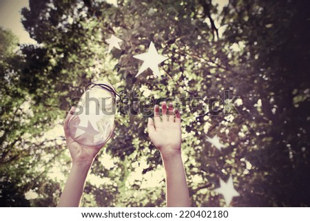 Catching wishes. Focus on Jar, Instagram effect. - stock photo