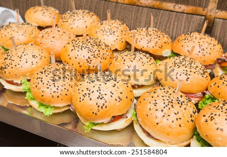 Catering american style - served table with plenty of hamburgers - stock photo