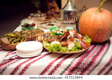 Catering banquet table with food snacks, arranged with pumpkin