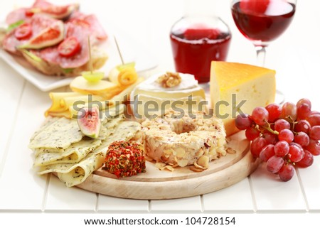 Catering cheese platter with red wine - stock photo