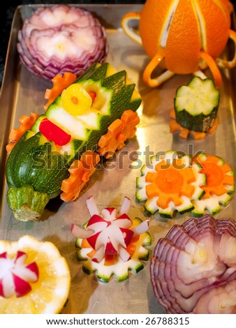 Catering display of vegetables garnish sculpture buffet - stock photo