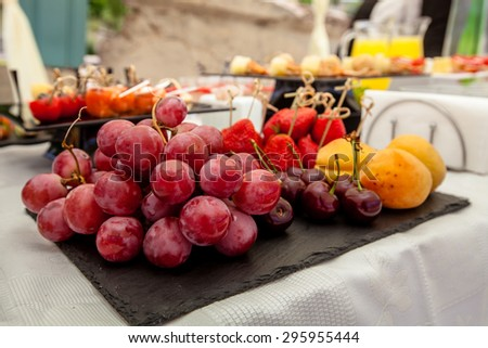 Catering event. Buffet table closeup. Fruits on banquet table. - stock photo