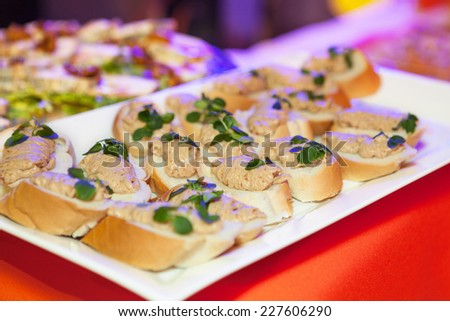 Catering food at a wedding party - canap - stock photo