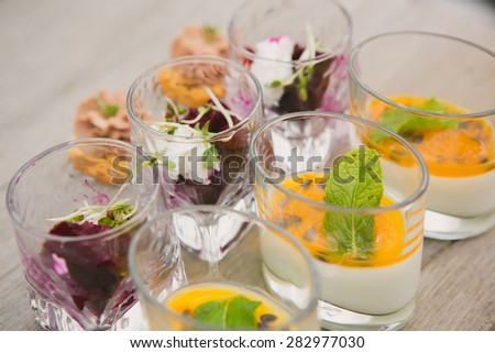 Catering. Salad in a glass on a wooden table - stock photo