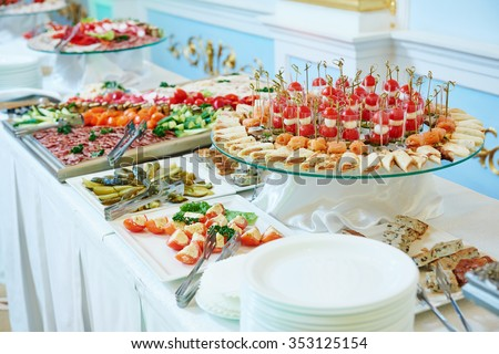 Catering service. Restaurant table with food at event. Shallow depth of view - stock photo