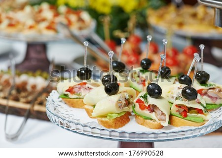 catering services background with snacks and food in restaurant - stock photo