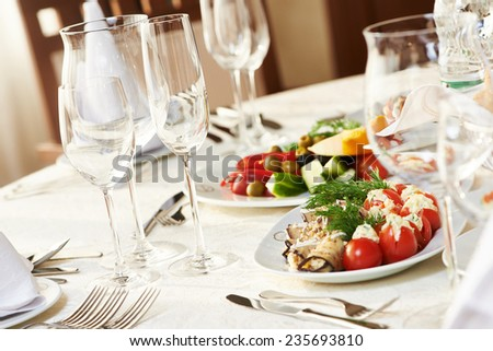 catering services background with snacks and glasses of wine on bartender counter in restaurant - stock photo