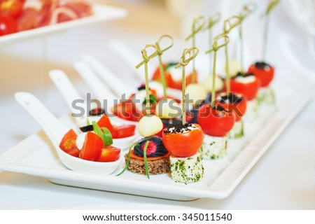 Catering services. Close-up macro dish with food meal in restaurant. Shallow DOF - stock photo