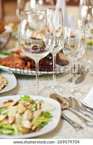 Catering services. Empty glasses set and food in restaurant - stock photo