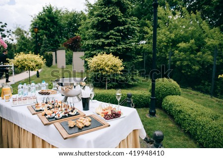 catering services in restaurant. Wedding table reception on wedding ceremony in the park
