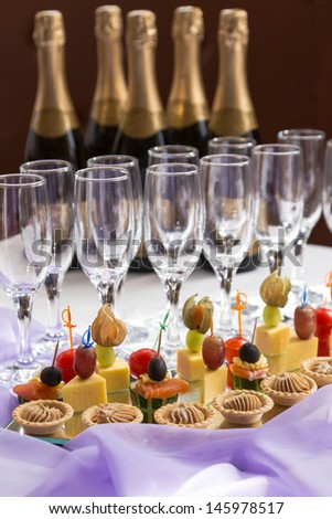 catering serving buffet with canapes and champagne