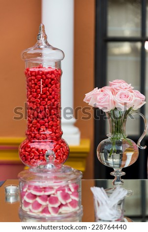 Catering sweets. A variety of tasty candies in cliche candy jar. - stock photo