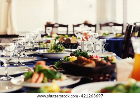 catering table set service with silverware and glass stemware