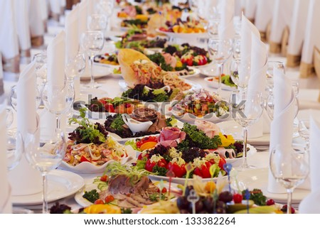 catering table set service with silverware and glass stemware at - stock photo