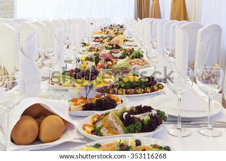 catering table set service with silverware and glass stemware at restaurant