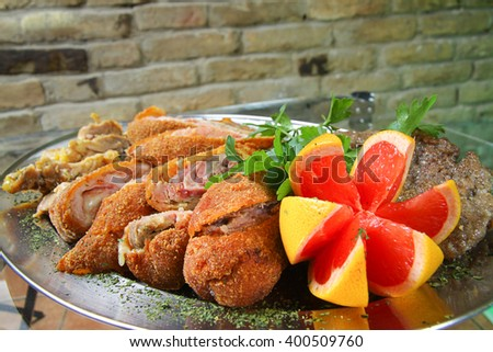 Catering tray with various meats - stock photo