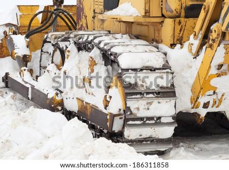 caterpillar of bulldozer on snow - stock photo