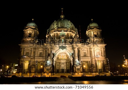 cathedral and tv tower of berlin at night (germany) - stock photo