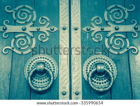 Cathedral door. Lisbon, Portugal. Toned photo. - stock photo