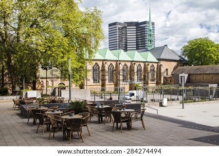Cathedral in Essen and modern business tower, city skyline - stock photo