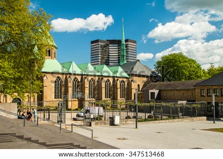 Cathedral in Essen, Germany, and modern business tower, city skyline - stock photo