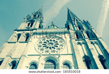 Cathedral of Chartres and the traces of the planes in the sky. Chartres, France. Aged photo.  - stock photo