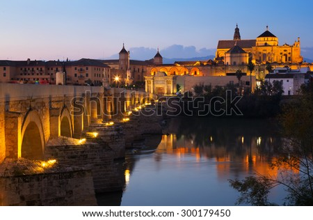 Cathedral of Cordoba and Roman bridge in evening. Andalusia, Spain