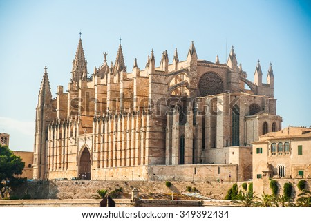 Cathedral of Palma de Mallorca, rear view from road. Big gothic church on the sea shore. Beautiful travel picture of Spain. - stock photo