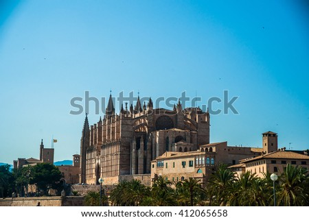 Cathedral of Palma de Mallorca, rear view from road. Big gothic church on the sea shore. Beautiful travel picture of Spain.