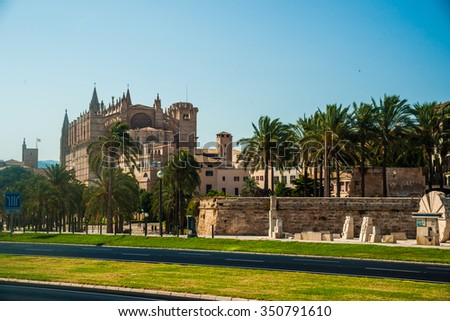 Cathedral of Palma de Mallorca viewed from road. Big gothic church on the sea shore. Beautiful travel picture of Spain. - stock photo