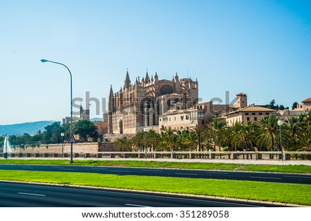 Cathedral of Palma de Mallorca viewed from road. Big gothic church on the sea shore. Beautiful travel picture of Spain.