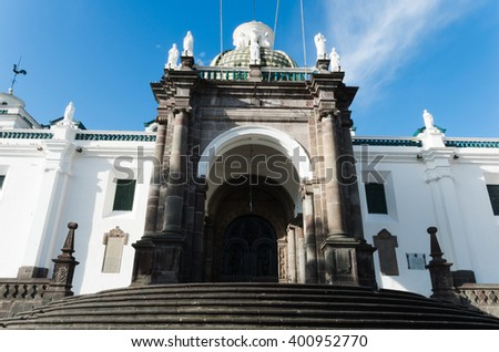 Cathedral of Quito city, close up of main entrance and stairs in a sunshine day - stock photo