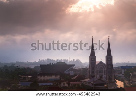 cathedral of roman catholic with sunlight through clouds in background